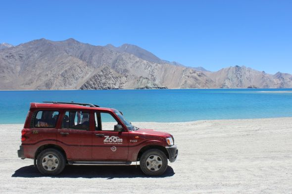 A Mahindra Scorpio Self Driven SUV at Pangong Tso Pic