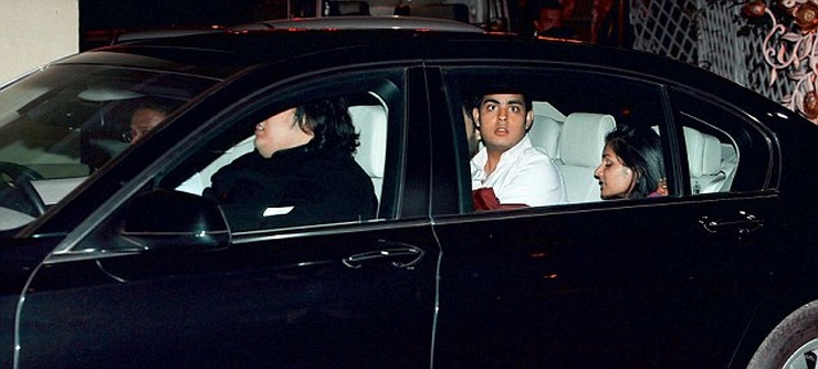 Mukesh Ambani's kids in a car