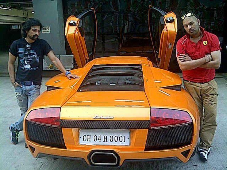 Yuvraj Singh with his Orange Lamborghini Murcielago 1