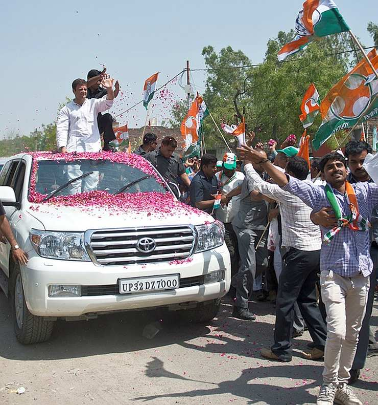 indian politician and his toyota in a parade