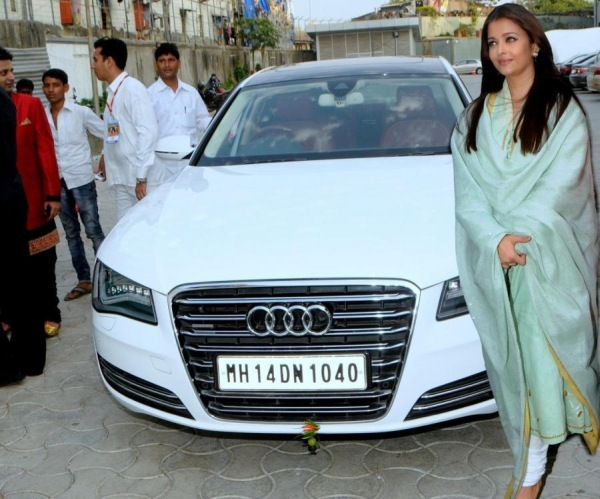 Aishwarya Rai Bachchan snapped posing with her Audi A8 car at the National Sports Club of India in Mumbai on April 27, 2014. (Photo: IANS)