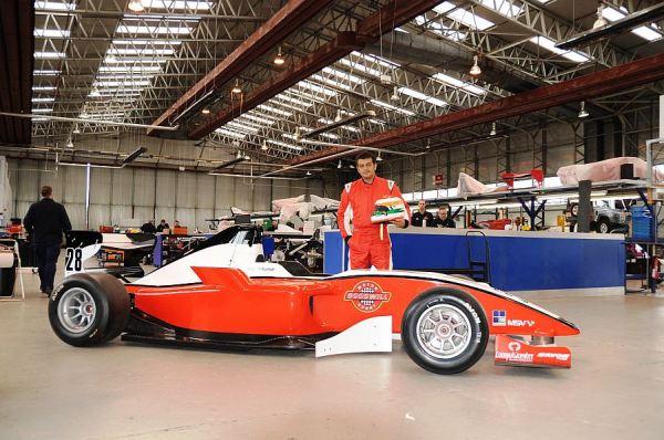 Ajith Kumar with a Formula2 Race Car