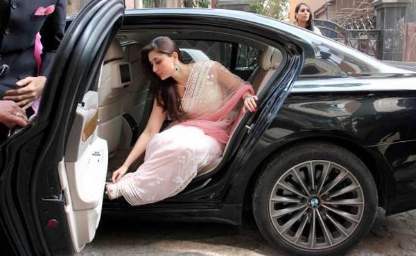 Kareena Kapoor in a BMW 7-Series luxury saloon