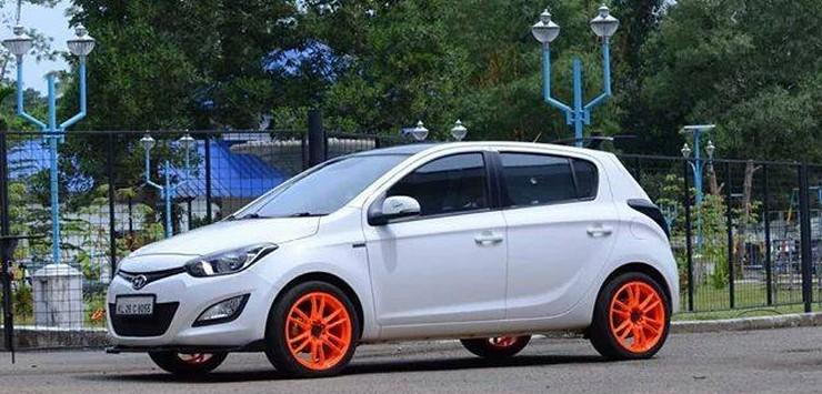Hyundai i20 with orange wheels