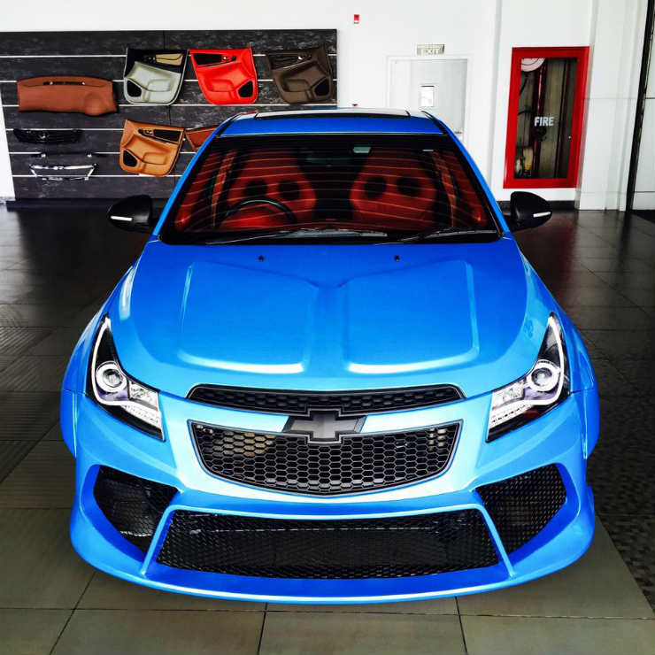 This modded Chevrolet Cruze with wide body is red hot