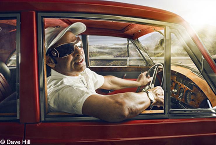 Bikram Choudhury driving his Rolls Royce