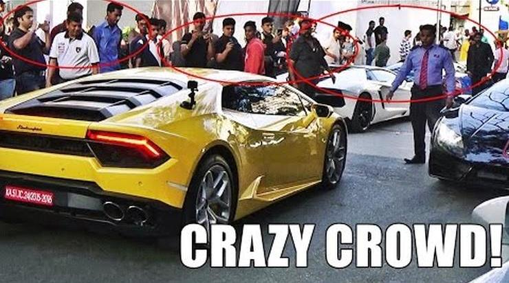 People crowd around Lamborghini in India