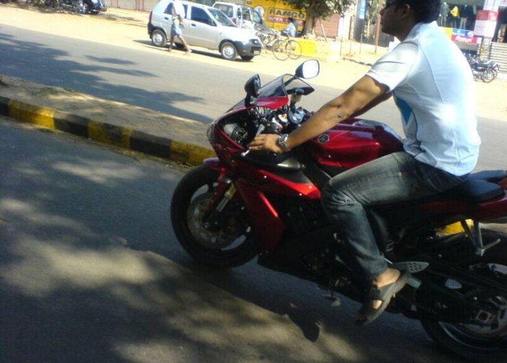 Superbike rider with no safety gear