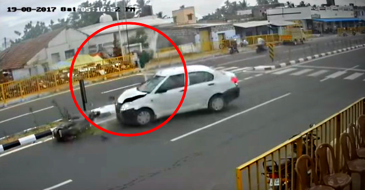 Woman thrown in air after Dzire crashes into scooter, miraculously survives