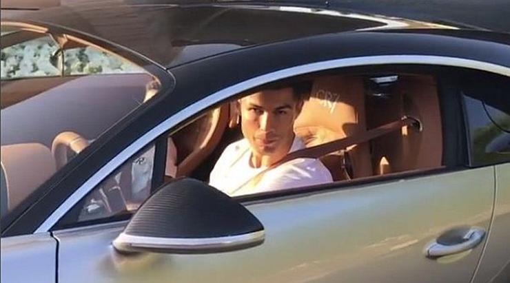 Cristiano Ronaldo with his Bugatti Chiron 1