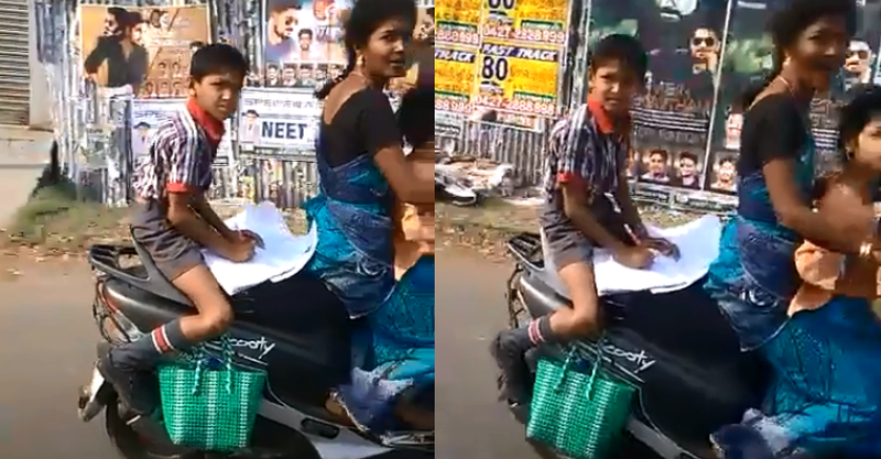 Kid doing homework on a moving scooter is the CRAZIEST thing you'll see today [Video]
