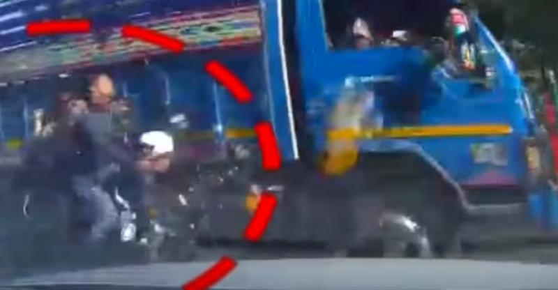 Bizarre motorcycle, truck & car crash leave one dead; Caught on dashcam video