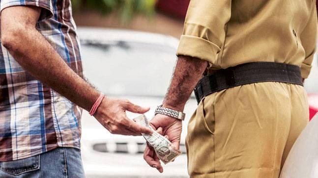 Bribing a Traffic Cop? Smile, you could be on camera!