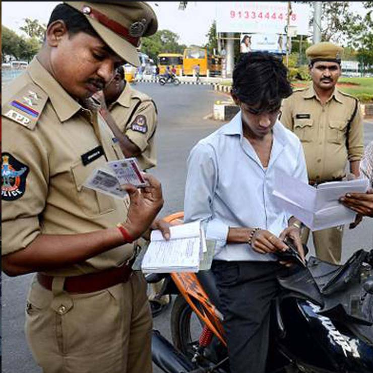 Honest traffic cop fines own son for riding motorcycle without helmet