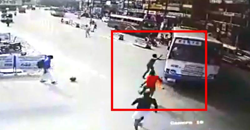 Blind overtaking goes wrong; Motorcycle gets crushed by bus [Video]