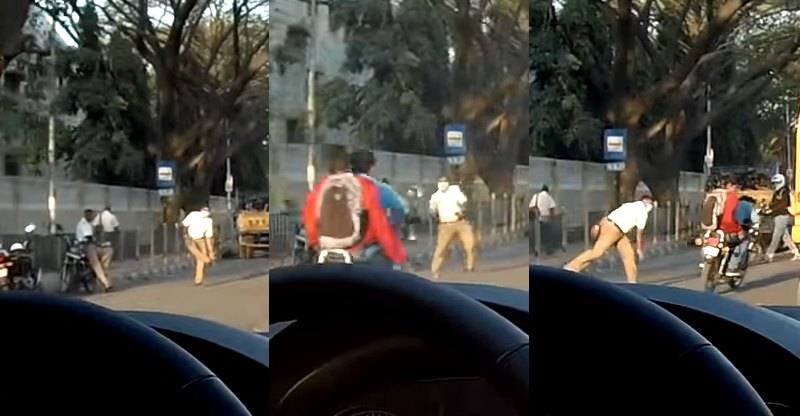 Bangalore cop sees helmet-less rider, hits him with his 'chappal' [Video]