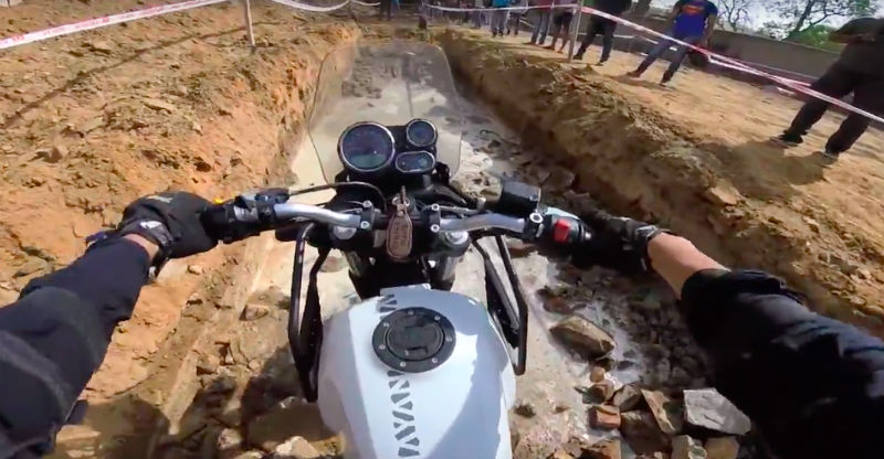 Royal Enfield Himalayan motorcycle crossing off-road obstacles