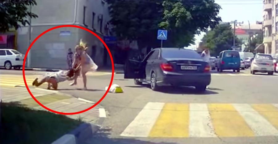 Woman in a Mercedes gets into a fist fight with pedestrian [Video]