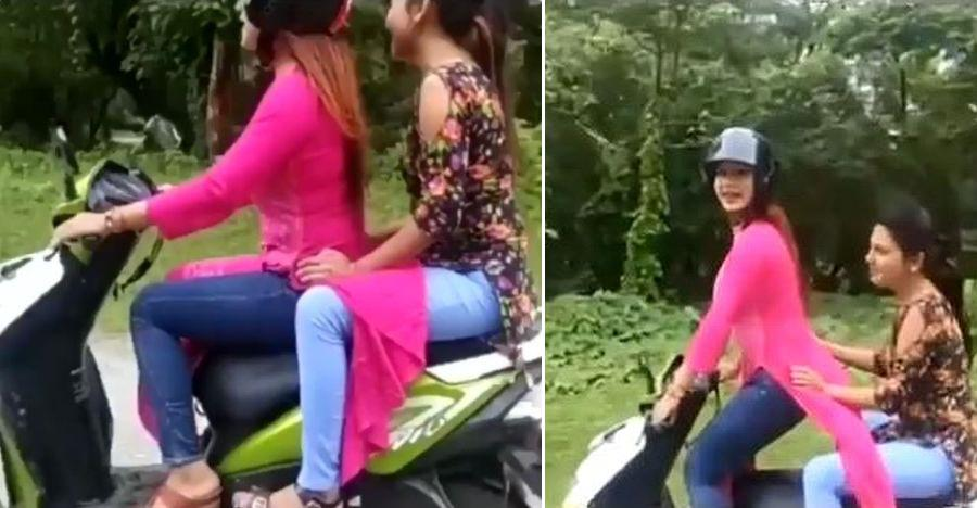 Man tries to help girl riding scooter: Total confusion ensues (Video)