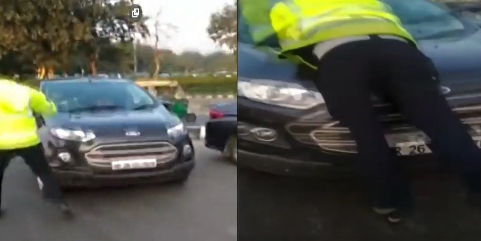 Wrong-side driver drives away with police constable on bonnet (Video)