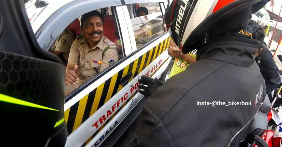 Friendly Kerala cop interacting with bikers wins hearts [Video]