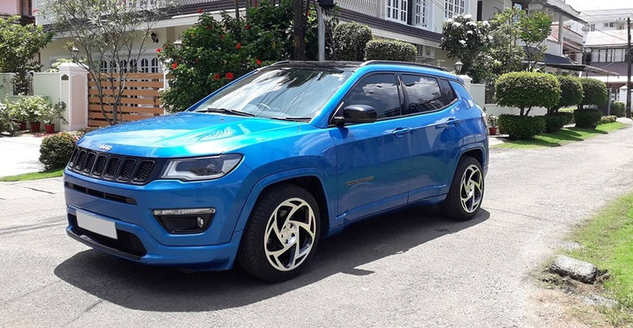 This GORGEOUSLY modified used Jeep Compass is up for sale