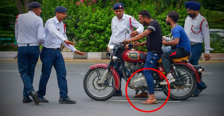 Man Riding Royal Enfield Classic While Wearing Chappals Featured