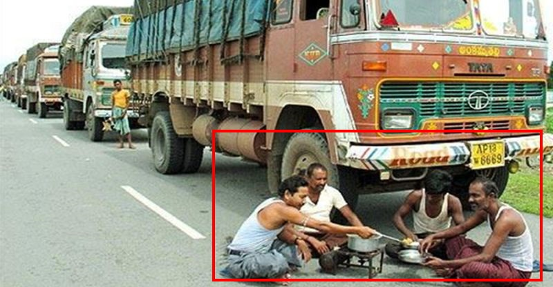 Truck Drivers In Lungi And Banian Featured