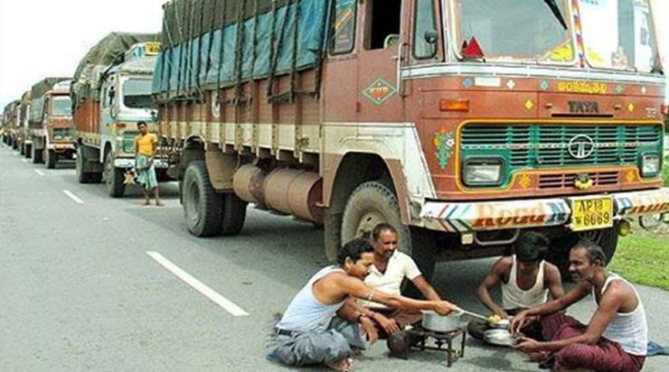 Truck Drivers In Lungi And Banian