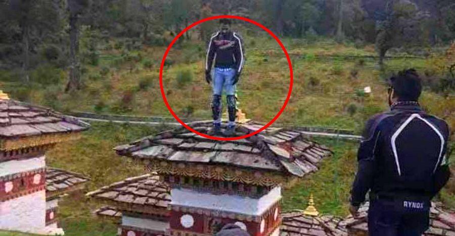 Indian biker detained by Bhutan police after he climbs on a Chorten
