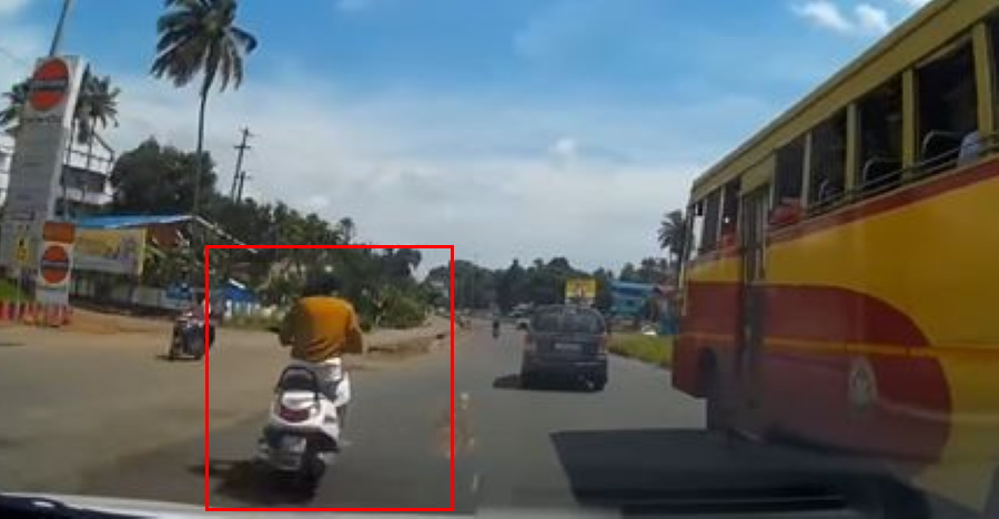 Car narrowly misses hitting a scooter while overtaking: Who is to blame? [Video]