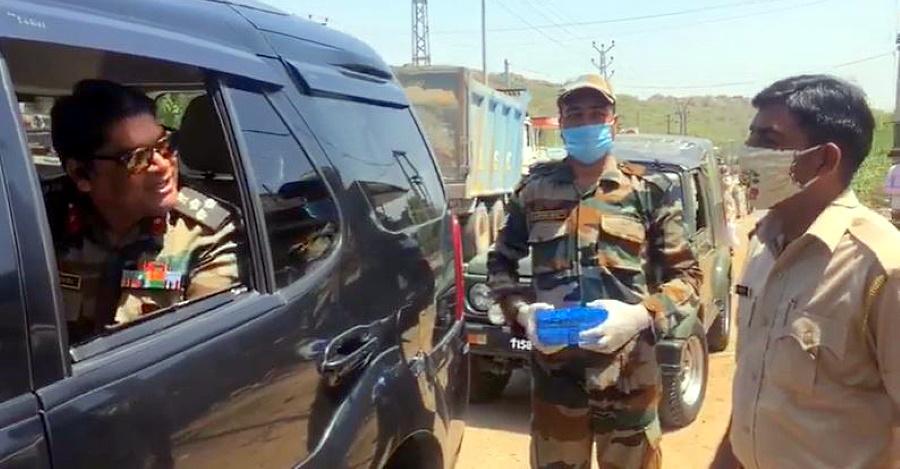 Army Brigadier in Tata Safari Storme stops SUV: Distributes sweets to cops on COVID duty [Video]