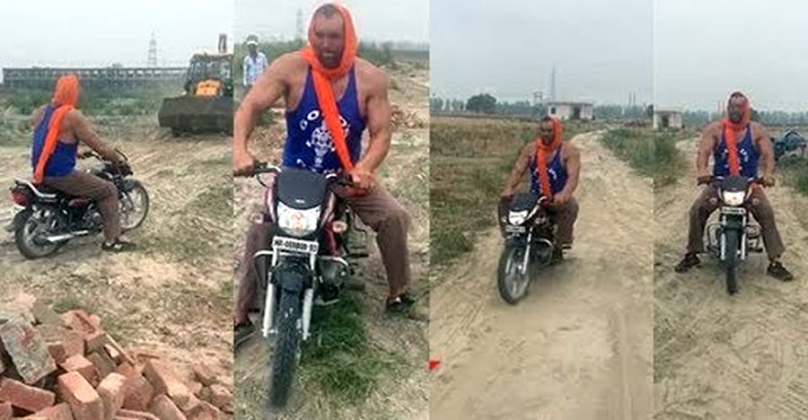 Great Khali goes off roading on a Hero HF Deluxe 100cc commuter bike: Gets STUCK [Video]