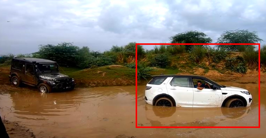 Expensive Land Rover Discovery rescued by a humble Mahindra Thar [Video]