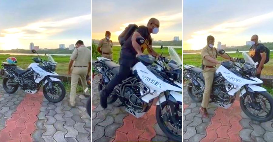 Rider teaches curious cop how to get onto the massive Triumph Tiger 800 [Video]