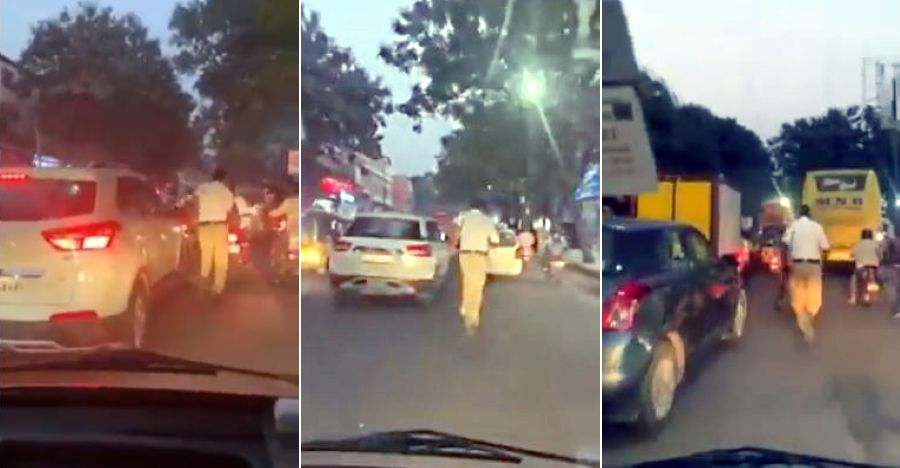 Indian cop runs ahead of ambulance for for 2km to make way in traffic jam [Video]