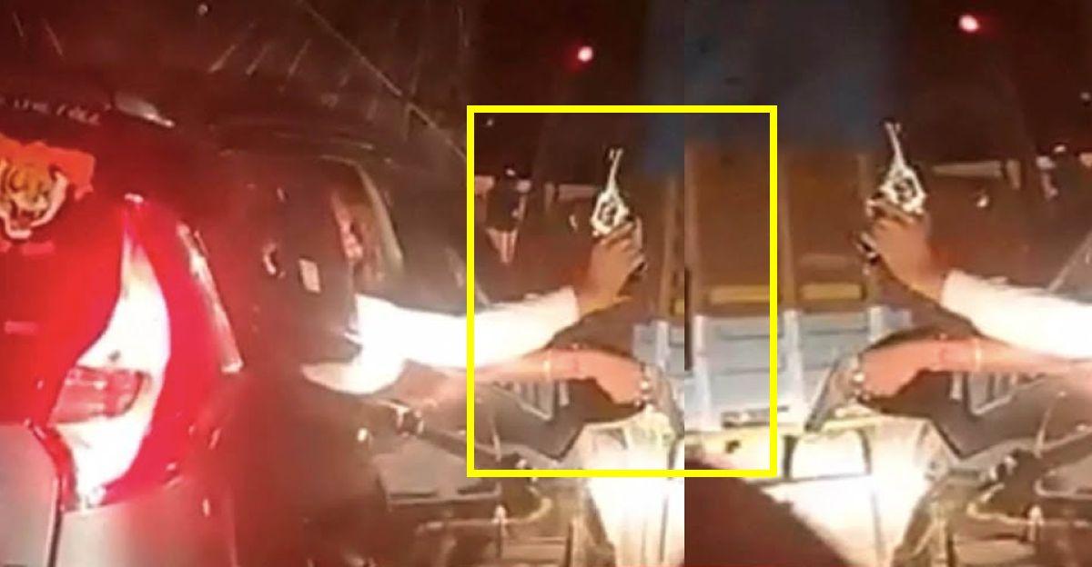Men in Mahindra Marazzo show guns to overtake trucks on Maharashtra highway