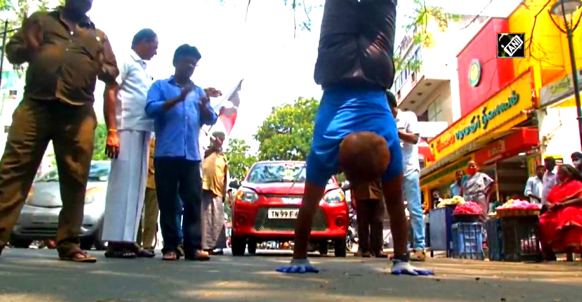 Yoga instructor pulls a Maruti Suzuki Alto 800 while walking upside down in election rally