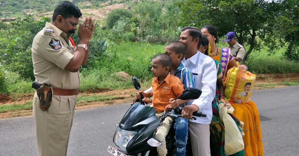 Travelling with a child without a helmet? You can get a challan