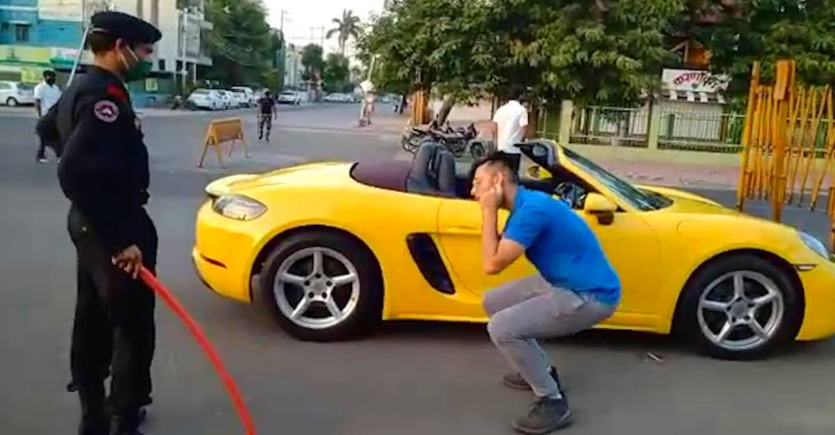 That moment when a Porsche owner was made to do sit-ups in the middle of the road