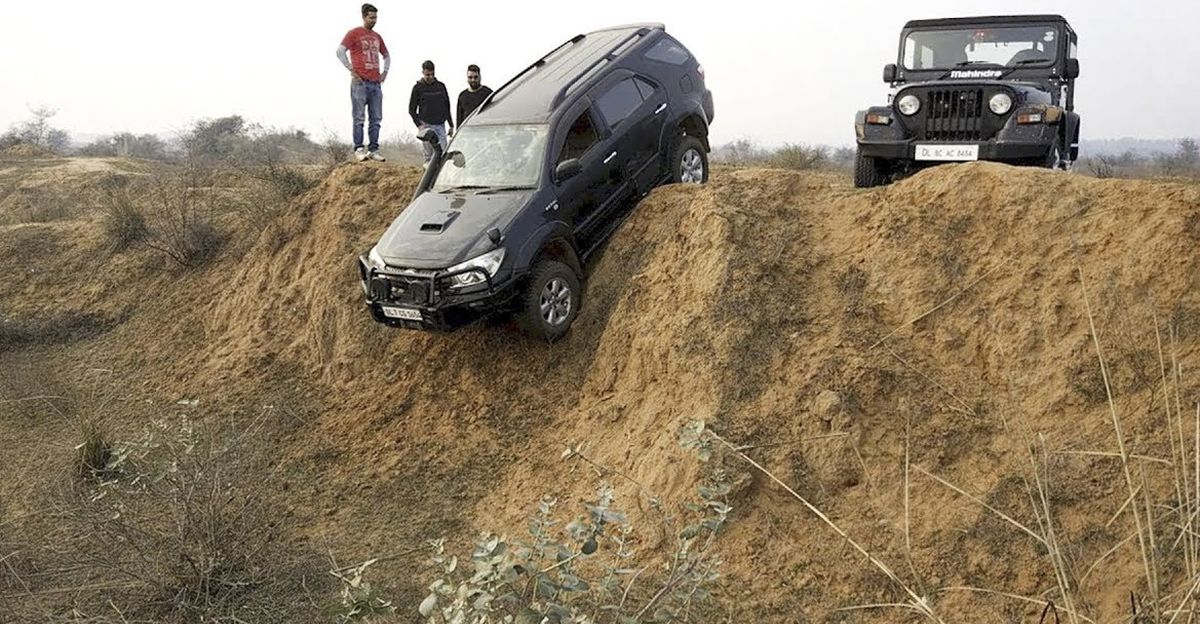 Toyota Fortuner, Mahindra Thar, Safari Storme & Ford Endeavour try a vertical drop: Which SUV will make it?