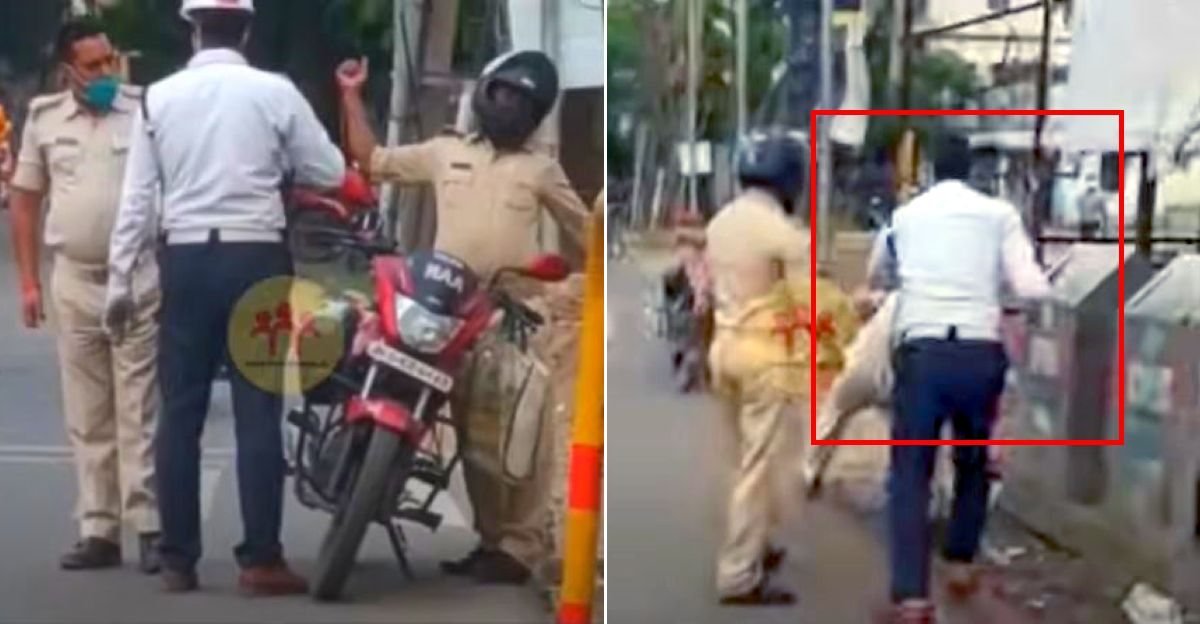 Traffic policeman stops a cop for not wearing a helmet: Both start fighting [Video]