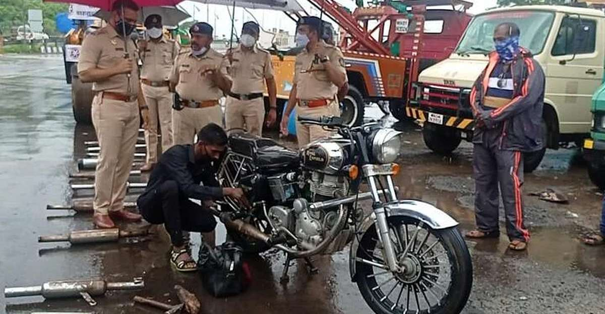 Thane police officials begin drive against loud silencers & black window tints