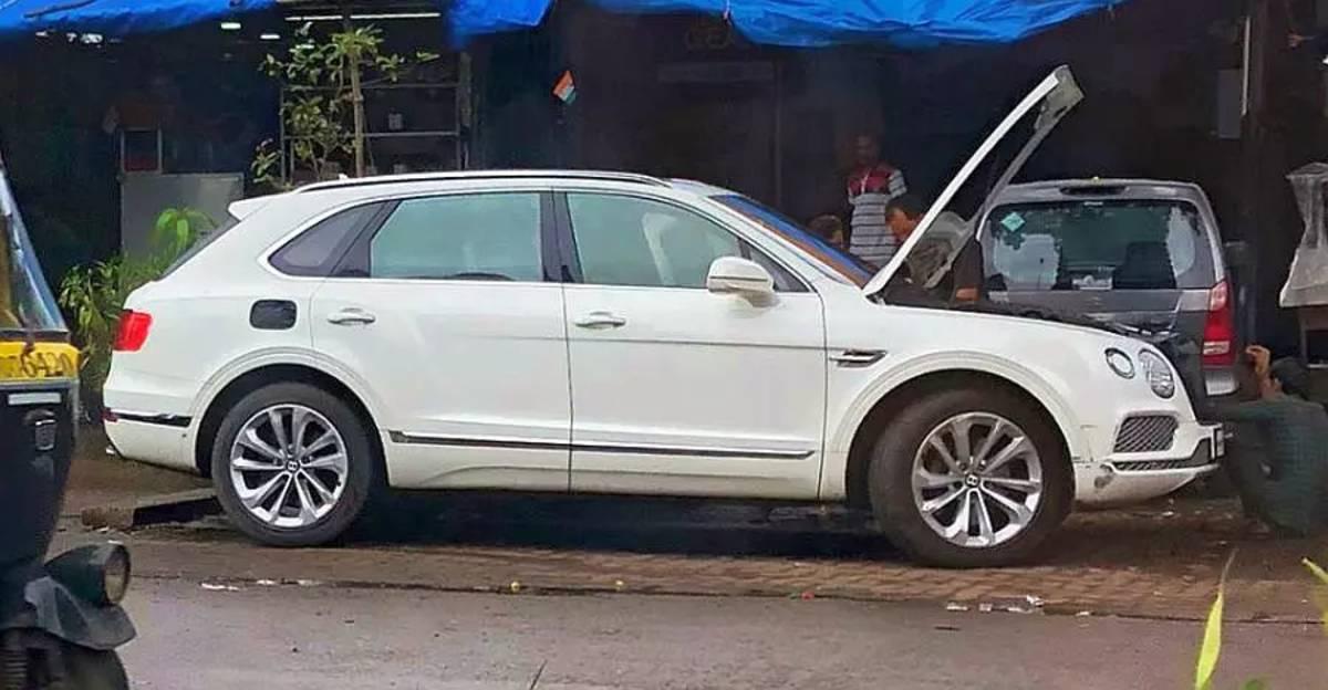 Multi-crore Bentley Bentayga SUV spotted getting fixed at a roadside garage in Mumbai