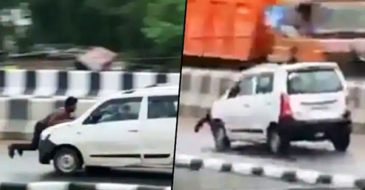 Man drives off at high speed with truck driver on his car's bonnet: Police launch manhunt [Video]