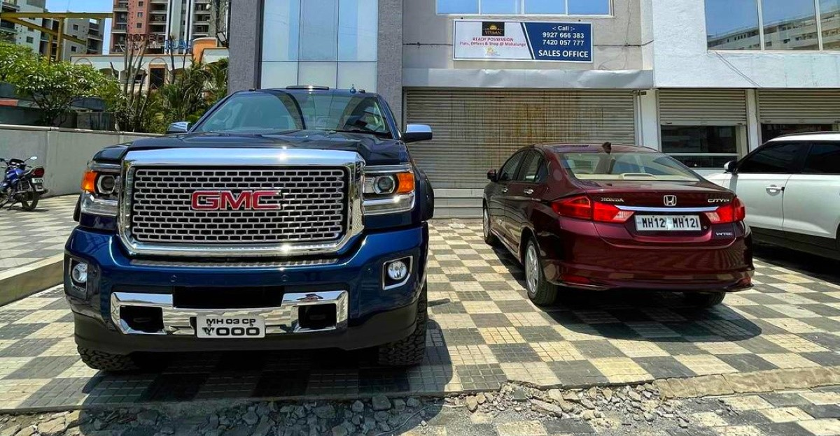 GMC Denali next to a Honda City looks gigantic