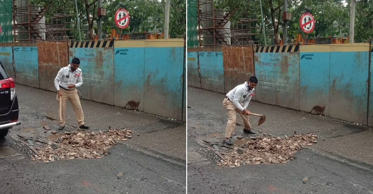 Two traffic cops in Mumbai fill potholes to ease congestion