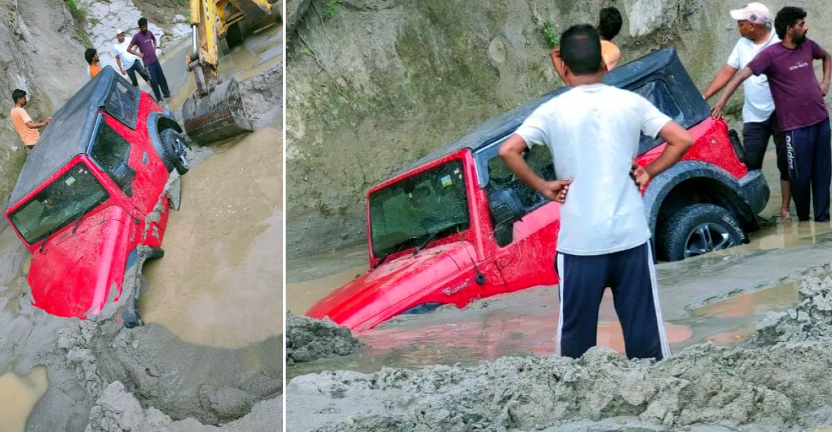 New Mahindra Thar trying to cross river drowns after flash floods: JCB rescues it