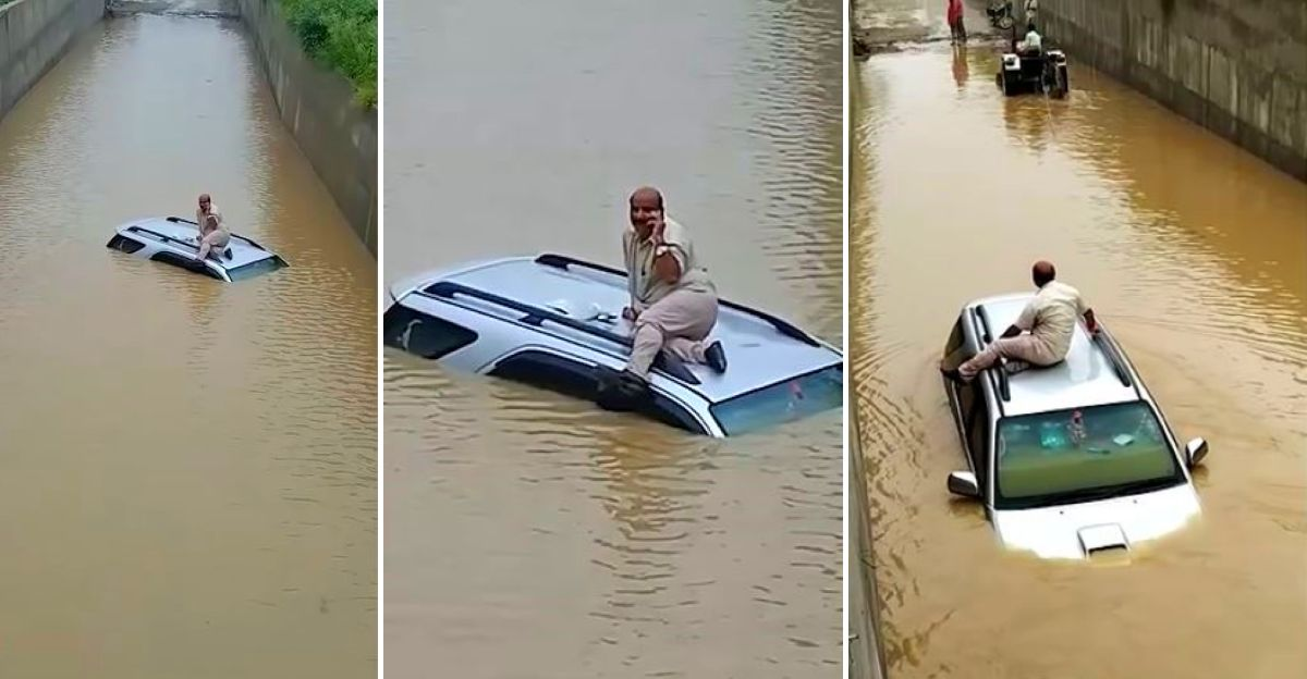 Toyota Fortuner gets stuck in a flooded underpass: Rescued by a tractor