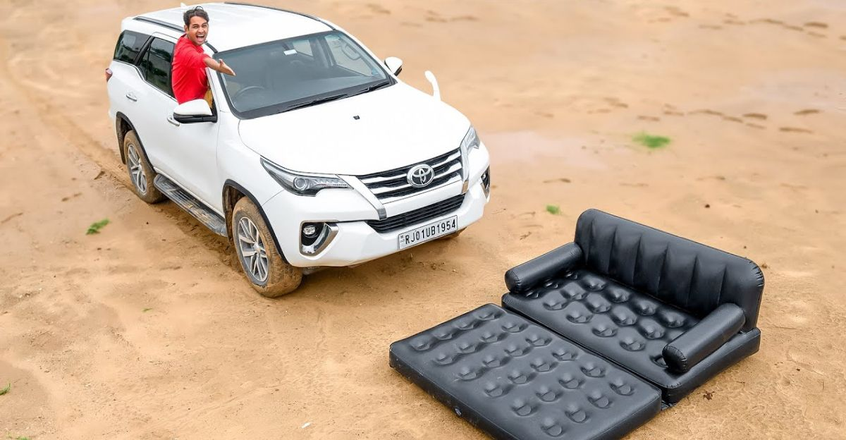 Toyota Fortuner driven over air sofa to test strength is sheer craziness